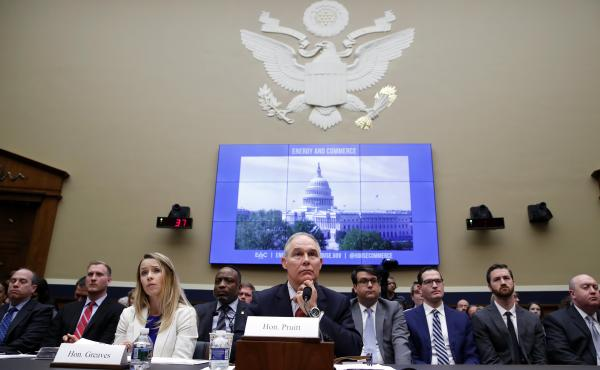 EPA Administrator Scott Pruitt, accompanied by EPA Chief Financial Officer Holly Greaves, testifies before a House Energy and Commerce subcommittee on Capitol Hill on Thursday.