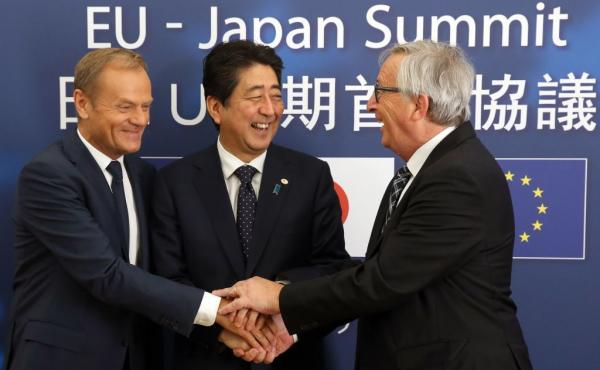 European Council President Donald Tusk (left), Japanese Prime Minister Shinzo Abe (center) and President of the European Commission Jean-Claude Juncker meet at the European Council on Thursday in Brussels.
