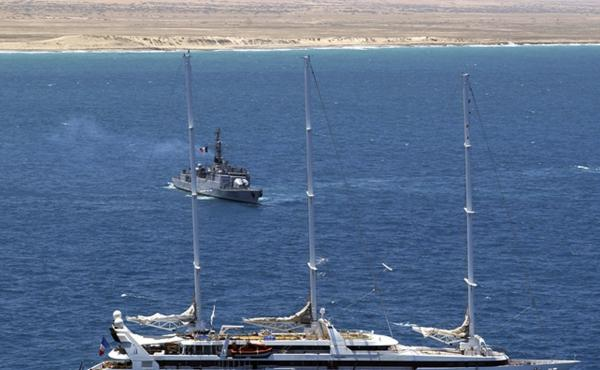 Zodiac commando boats arrive at the rear of the French luxury yacht Le Ponant, whose crew was held hostage by pirates, in April 2008. The French navy frigate Le Commandant Bouan is seen in the background, off Somalia's coast.