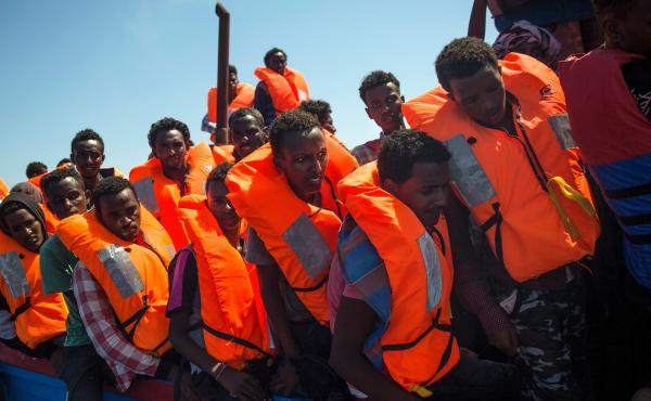 Europe's top court has dismissed a legal action by Hungary and Slovakia, which challenged a system that required them to take in refugees. Above, migrants wait to be rescued by a ship in the Mediterranean off the Libyan coast last month.
