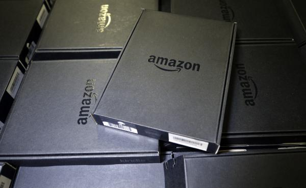 Kindle e-readers were piled high at an Amazon Fulfillment Center. The central focus of the nascent European probe will be Amazon's e-book agreements with publishers.