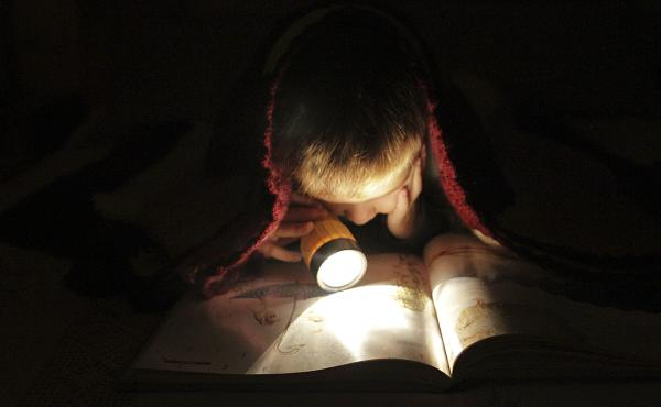 Pssssst, kid: If you go to bed early enough, you might still have a bit of time for covert reading before nodding off.
