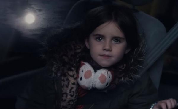 """An image from a new Christmas ad from British retailer John Lewis. Titled """"Man on the Moon,"""" the ad follows a girl's attempts to connect with a man she spots living on the moon."""