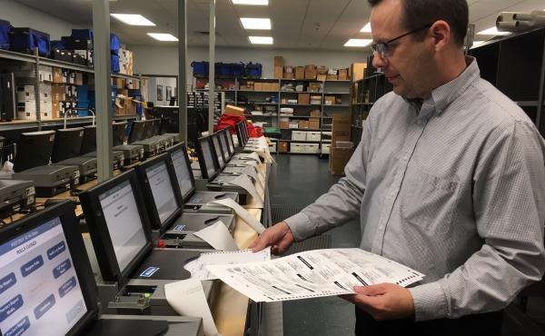 Gaston County Elections Director Adam Ragan tests equipment.