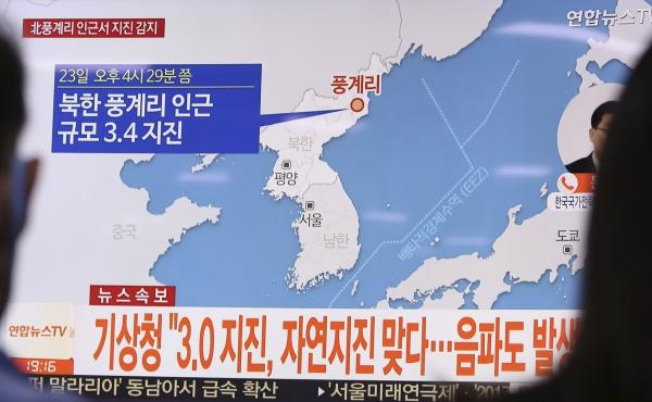 News of the earthquake in North Korea is reported at the Seoul railway station in South Korea on Saturday.
