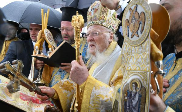 Ecumenical Patriarch Bartholomew I, shown here at a ceremony in January, has ordered churches around the world to halt services until at least the end of the month.