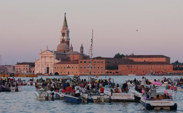 Venetians celebrate during the Festa del Redentore in Venice. The festival began in 1576 when the Republic's Senate voted to build a church on the Giudecca Island to Christ the Redeemer to thank God for the city's deliverance from the Plague.