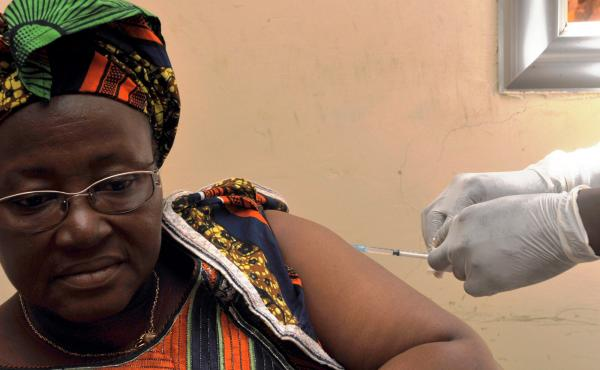 A woman receives the rVSV-ZEBOV Ebola vaccine at a clinical trial in Conakry, Guinea. The vaccine appears effective after only one shot.