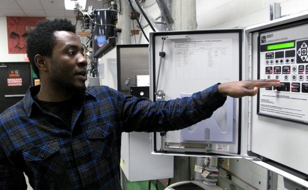 Jeffy Docteur is one of the students in the NStar electrician apprenticeship program outside Boston. He says he's interested in working on switching systems that keep power flowing through the electrical grid.