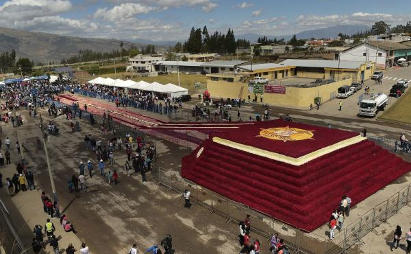 An aerial view from Saturday shows a floral pyramid of more than 500,000 roses, an attempt to set a Guinness World Record in Tabacundo, Ecuador.