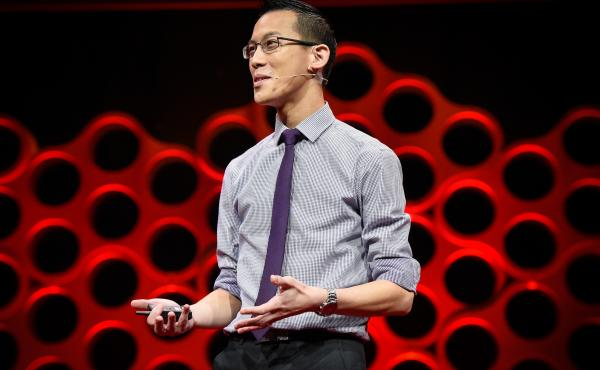 Eddie Woo on the TED stage.