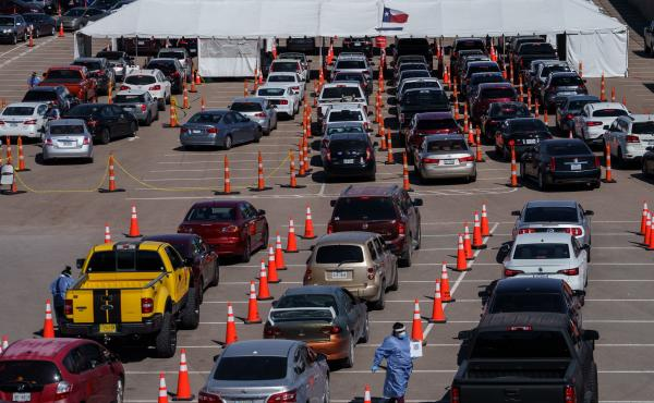 Cars line up Friday at a coronavirus testing site at the University of Texas at El Paso. The area has seen a surge in cases in recent weeks, and a two-week curfew is now in effect in El Paso County.
