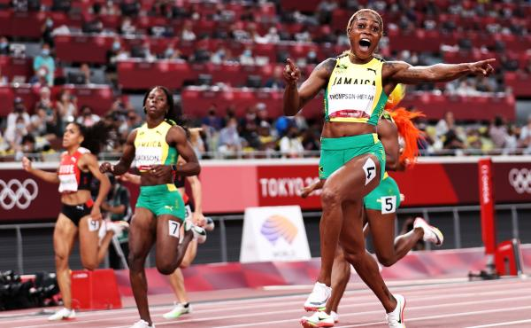 Elaine Thompson-Herah of Team Jamaica crosses the finish line to win the gold medal in the women's 100-meter final at the Tokyo Olympic Games on Saturday.