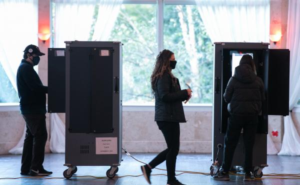 Voters in Atlanta casting their ballots on voting equipment made by Dominion Voting Systems. After losing the election, former President Trump and his allies spread conspiracy theories about the company, which has responded with defamation suits to combat