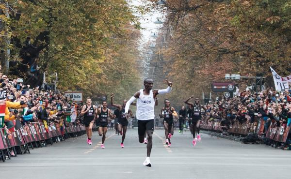 Kenya's Eliud Kipchoge celebrates after busting the elusive two-hour barrier for the marathon Saturday in Vienna.