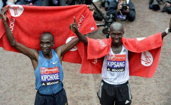 Kenya's Eliud Kipchoge (left) celebrates winning the London Marathon next to runner-up and last year's winner Wilson Kipsang, also of Kenya, on Sunday.