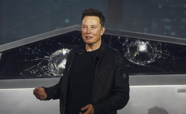 Tesla co-founder and CEO Elon Musk introduces the Cybertruck at Tesla's design studio in Hawthorne, Calif. The much-hyped unveiling of the company's electric pickup truck went off script Thursday night when supposedly unbreakable window glass was smashed
