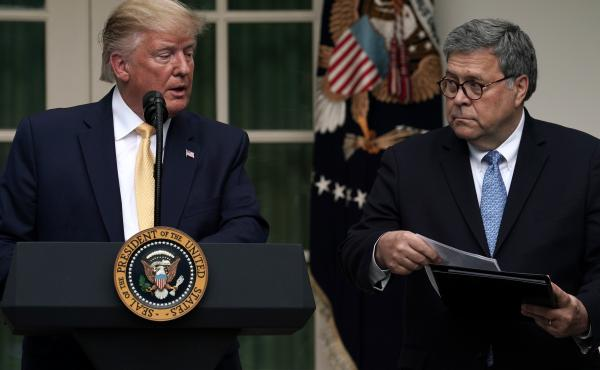 President Trump and U.S. Attorney General William Barr announce the Trump administration's decision to back down from its push for a citizenship question in the White House Rose Garden in July.