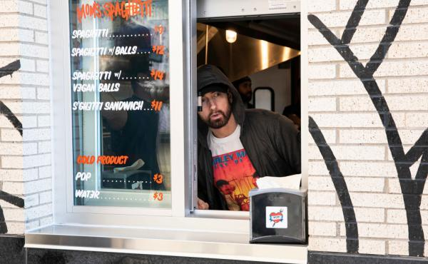 Eminem serves customers on the opening night of his restaurant Mom's Spaghetti in Detroit on Wednesday.