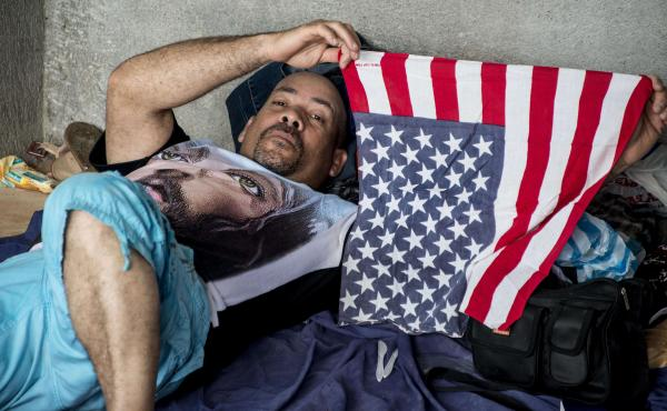 "A Cuban migrant bound for the U.S. by way of Central America rests in a shelter in Costa Rica in November 2015. Until President Barack Obama ended the so-called ""wet foot, dry foot"" policy on Thursday, Cubans who reached U.S. soil either by sea or land we"