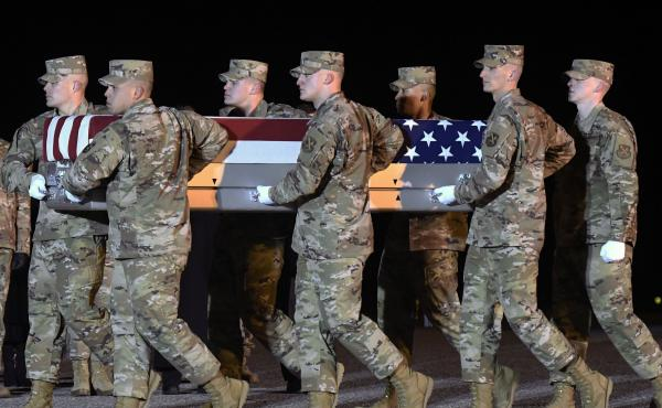 The remains of Lt. Col. Paul  Voss return home, Dover Air Force Base, Del. Voss was one of two Air Force aviators killed in a crash in Afghanistan last January.