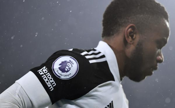 """A """"No room for racism"""" logo and Premier League logo is seen on the shirt of Ademola Lookman of Fulham during the Premier League match."""
