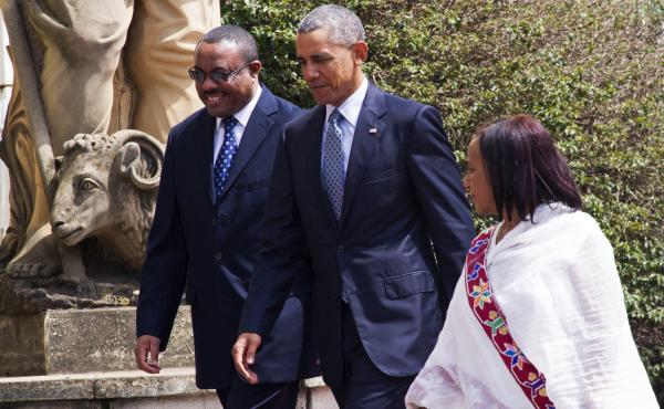 Ethiopian Prime Minister Hailemariam Desalegn (left), walks alongside President Obama during the U.S. president's visit to the African nation last July. Critics say Ethiopia has cracked down hard on the opposition, but makes modest gestures to give the im