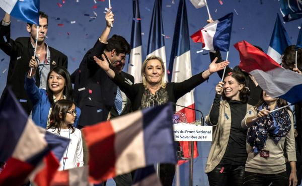 Marine Le Pen (center), leader of France's far-right National Front party, has visited Russia on several occasions, and a Russian bank recently lent her party $11 million.