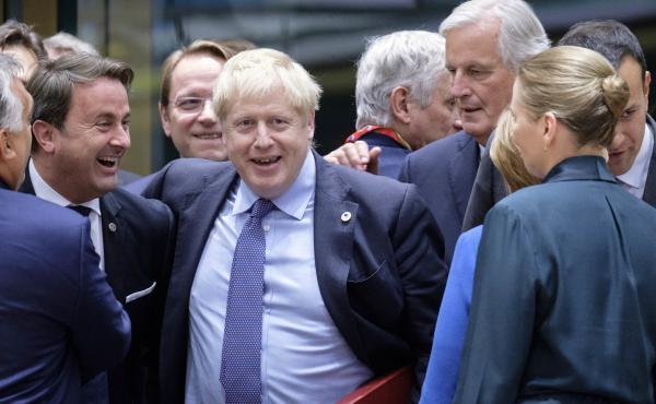 Luxembourg's Prime Minister Xavier Bettel (from left), U.K. Prime Minister Boris Johnson and the European Commission's chief Brexit negotiator, Michel Barnier, at the start of an EU summit on Thursday in Brussels. EU and British negotiators came to an agr