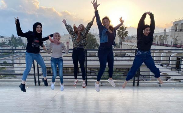 """Aysha Abu Shhab (right) and Noam Shuster-Eliassi (second from right) with other COVID-19 patients quarantined by the Israeli military at the Dan Jerusalem Hotel, which became known as """"Hotel Corona."""""""