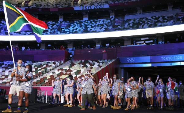 Flag bearers Phumelela Luphumlo Mbande and Chad Le Clos of Team South Africa lead their team out during the opening ceremony of the Tokyo Olympic Games on Friday.