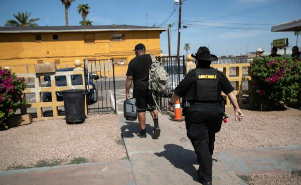 Maricopa County constable Darlene Martinez evicts a tenant on October 7, 2020 in Phoenix, Arizona. Thousands of court-ordered evictions continue nationwide despite a Centers for Disease Control (CDC) moratorium for renters impacted by the coronavirus pand