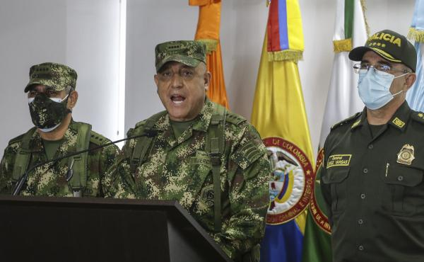 Colombian Armed Forces Commander Gen. Luis Fernando Navarro (center), National Police Director Gen. Jorge Luis Vargas (right), and Army Commander Gen. Eduardo Zapateriro give a press conference regarding the alleged participation of former Colombian soldi