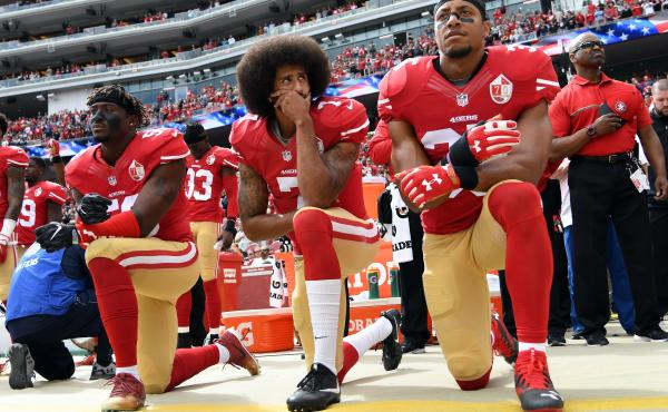 Former San Francisco 49ers quarterback Colin Kaepernick (middle) knelt on the sidelines during the national anthem to protest what he saw as the oppression of African-Americans in the United States.