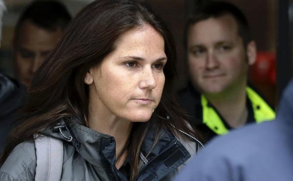 Former University of Southern California soccer coach Laura Janke exiting a Boston federal court Tuesday, where she pleaded guilty to charges in a nationwide college admissions bribery scandal.