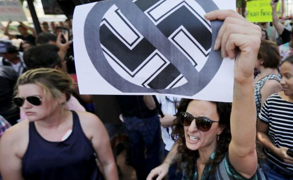 Protesters shout anti-Nazi chants after chasing alt-right blogger Jason Kessler from a news conference on Aug. 13 in Charlottesville.