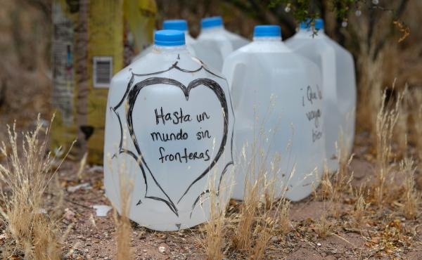 Jugs of water for undocumented immigrants sit along migrant trails after being delivered by volunteers for the humanitarian aid group No More Deaths. The number of immigrant deaths, mostly due to dehydration and exposure, has risen as higher border securi