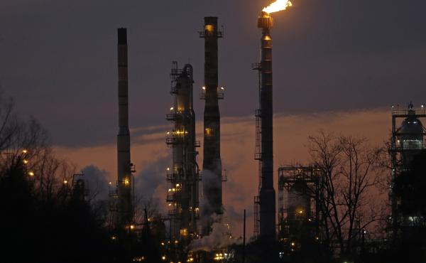 New York's attorney general is suing Exxon Mobil, accusing the company of defrauding shareholders. Above, an Exxon refinery in St. Bernard Parish, La., is seen in 2015.