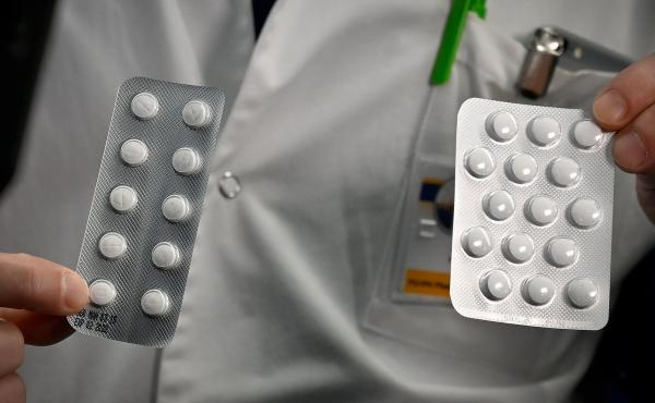 Medical staff in Marseille, France show packets of a Nivaquine, tablets containing chloroquine and Plaqueril, tablets containing hydroxychloroquine.