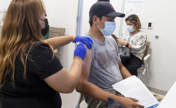This 16-year-old got his Pfizer-BioNTech COVID-19 shot late last month at the UCI Health Family Health Center in Anaheim, Calif. Students as young as 12 are now eligible to get the vaccine, too, the FDA says.