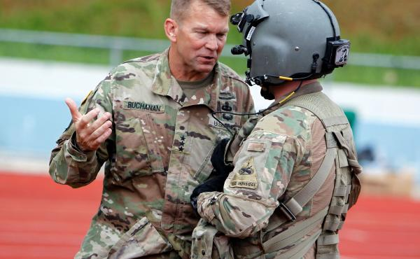 Lt. Gen. Jeffrey Buchanan (left) talks to a U.S. Army helicopter crew member in Barranquitas, Puerto Rico, after a supply delivery mission for residents affected by Hurricane Maria, Oct. 23, 2017.