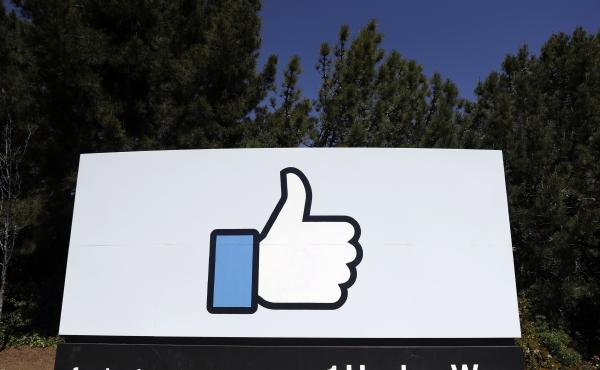 The Facebook logo photographed in 2018 at the company's headquarters in California. On Tuesday, Facebook said it found millions of user passwords stored in plain, readable text in its internal data storage systems.