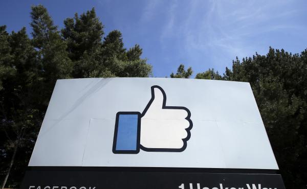 The thumbs-up Like logo on a sign at Facebook headquarters in Menlo Park, Calif. The Justice Dept. is suing the company for allegedly discriminating against U.S. workers in favor of temporary visa holders.