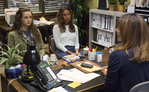 Actress Katherine Langford (left), who plays Hannah, a high school student who kills herself after enduring much bullying, and actress Alisha Boe (Jessica) sit in the counselor's office on 13 Reasons Why.