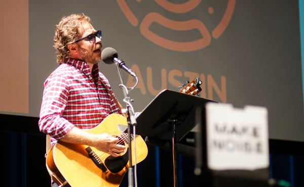 Ask Me Another's house musician Jonathan Coulton leads a music parody game at Cullen Performance Hall at the University of Houston, in Houston, Texas.