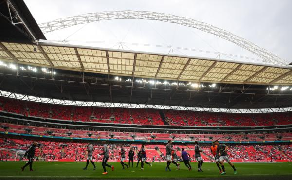 Manchester United players warm up in London's Wembley Stadium prior the FA Cup semifinal match against Tottenham Hotspur on Saturday. American billionaire Shahid Khan has made a bid to buy the stadium.