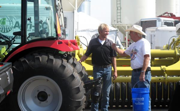 The Big Iron Farm Show draws thousands of farmers and farm equipment-makers to a fairground in West Fargo, N.D. For many this year, concerns about crop yields have been eclipsed by worries about President Trump's trade policies.