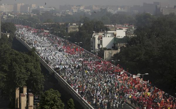 Indian farmers and agricultural laborers march towards the Indian Parliament during a protest rally in New Delhi, India, on Friday.
