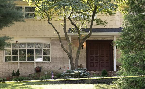 Crime scene tape surrounds the home of U.S. District Judge Esther Salas on Monday in North Brunswick, N.J. A gunman posing as a delivery person shot and killed Salas' 20-year-old son and wounded her husband Sunday evening  before fleeing, according to off