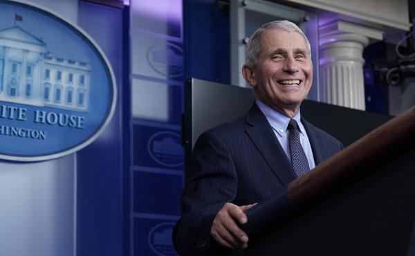 """Dr. Anthony Fauci laughs while speaking at a White House briefing on Thursday. Fauci, President Biden's chief medical adviser on COVID-19, says he rejoiced when the new president declared that """"science and truth"""" would guide the nation's policies toward t"""